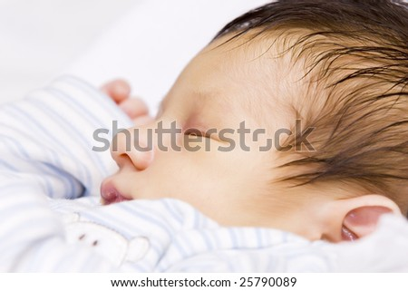 A portrait of a beautiful sleeping baby - stock photo