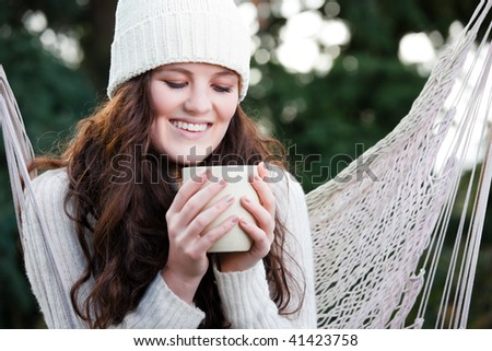 A portrait of a beautiful teenager outdoor drinking coffee - stock photo