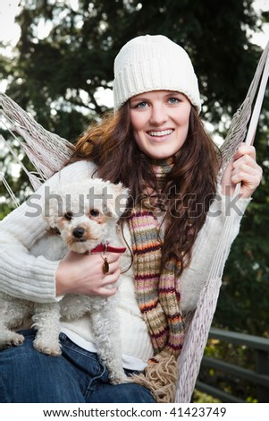 A portrait of a beautiful teenager outdoor relaxing with her dog - stock photo