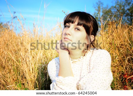 a portrait of a beautiful woman in a countryside - stock photo