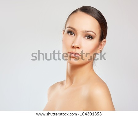 A portrait of a beautiful woman isolated on white background - stock photo