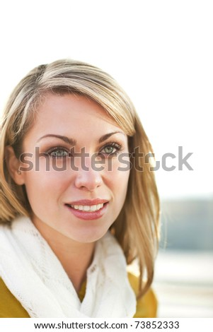 A portrait of a beautiful young caucasian woman smiling - stock photo