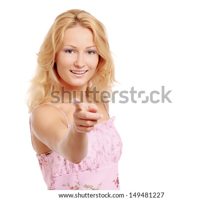 A portrait of a beautiful young woman pointing at you - isolated on white - stock photo