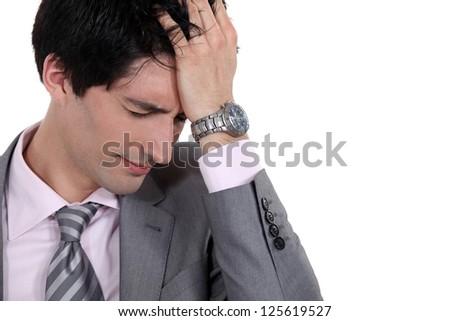 A portrait of a businessman having a headache. - stock photo