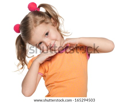 A portrait of a cheerful little girl in an orange shirt on the white background - stock photo