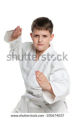 A portrait of a confident boy in kimono; isolated on the white background - stock photo