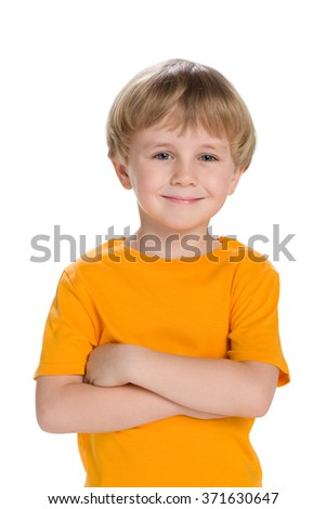 A portrait of a confident little boy in a yellow shirt - stock photo