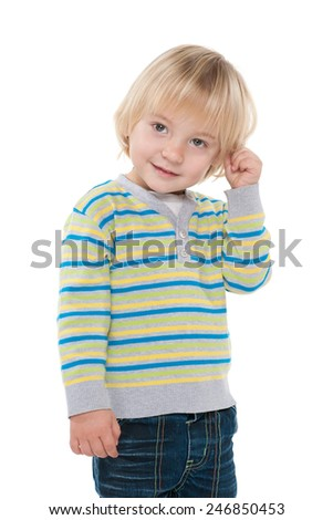 A portrait of a curious little boy against the white background - stock photo
