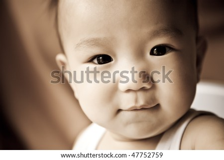 A portrait of a cute asian baby - stock photo