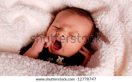 A portrait of a cute baby yawning - stock photo