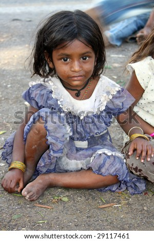 A portrait of a cute poor girl from India. - stock photo
