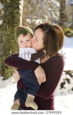 A portrait of a cute six month old and his mom. Shallow depth of field. - stock photo