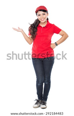 A portrait of a delivery young asian woman presenting to copyspace isolated in white background - stock photo