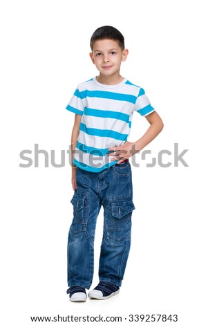 A portrait of a fashion little boy on the white background - stock photo