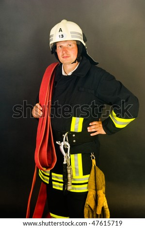 a Portrait of a fire fighter in uniform - stock photo