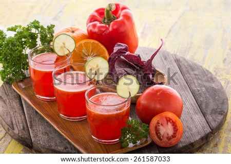 A portrait of  a glass juice combining red paprika, tomato and red spinach - stock photo