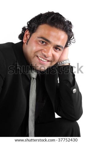 A portrait of a handsome young Indian businessman, on white studio background. - stock photo