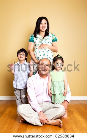 A portrait of a happy Asian family - stock photo