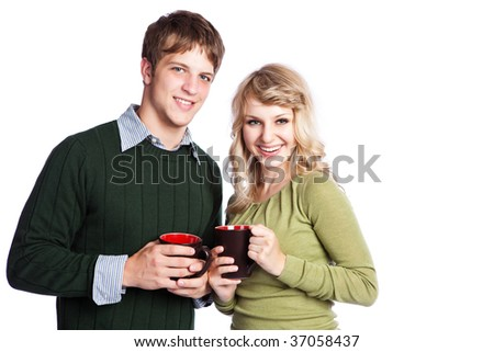 A portrait of a happy beautiful caucasian couple holding coffee cups - stock photo