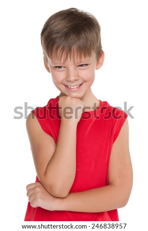 A portrait of a happy boy in a red shirt on the white background - stock photo