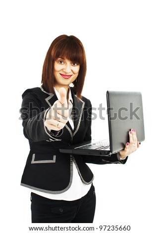 A portrait of a happy businesswoman holding a laptop and giving thumbs up. Isolated on white background - stock photo