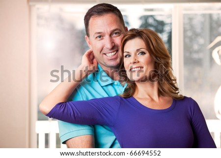 A portrait of a happy caucasian couple - stock photo