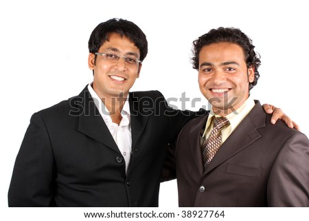 A portrait of a happy Indian businessmen after a successful deal, on white studio background. - stock photo