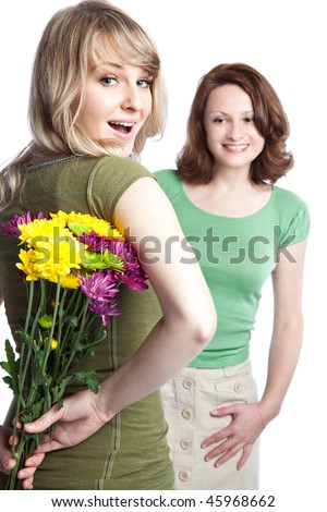 A portrait of a happy mother and daughter celebrating mother's day - stock photo