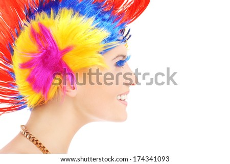 A portrait of a happy woman in a colorful makeup posing over white background - stock photo