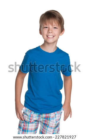 A portrait of a laughing young boy in a blue shirt on the white background - stock photo