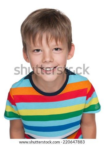 A portrait of a little happy boy in a striped shirt on the white background - stock photo