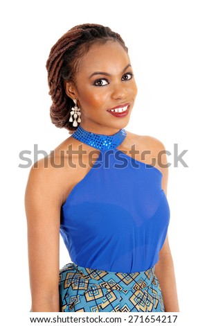 A portrait of a lovely African American woman smiling, in a blue blouse,  isolated for white background.  - stock photo