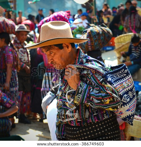 A portrait of a man in traditional clothing on the market of Solola, Guatemala.  - stock photo