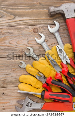 A portrait of a mechanical kit in wooden background. construction tool - stock photo