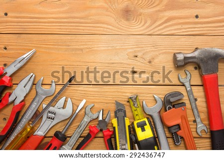 A portrait of a mechanical kit in wooden background. construction tool with a copy space - stock photo