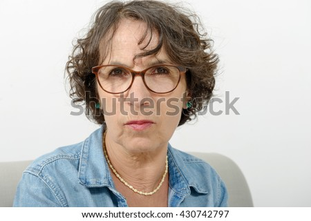 a portrait of a middle-aged woman angry - stock photo