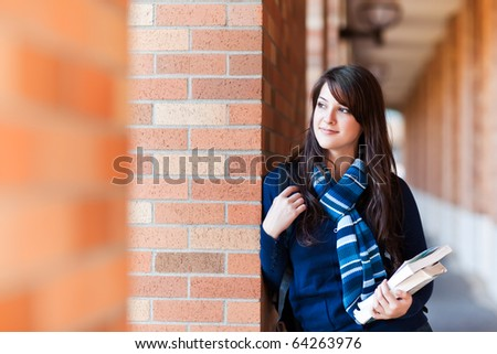 A portrait of a mixed race college student at campus - stock photo