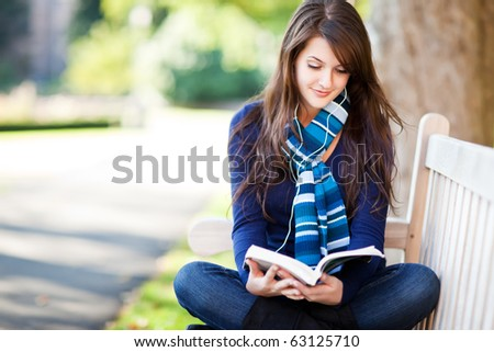 A portrait of a mixed race college student studying at campus - stock photo