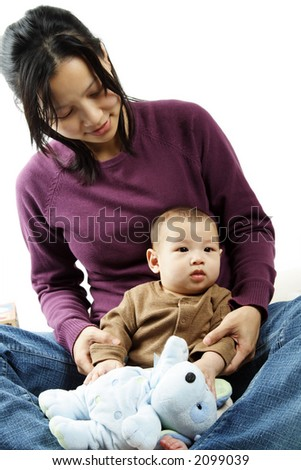 A portrait of a mother and her baby son - stock photo