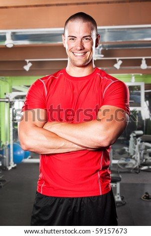 A portrait of a muscular caucasian athlete in a gym - stock photo