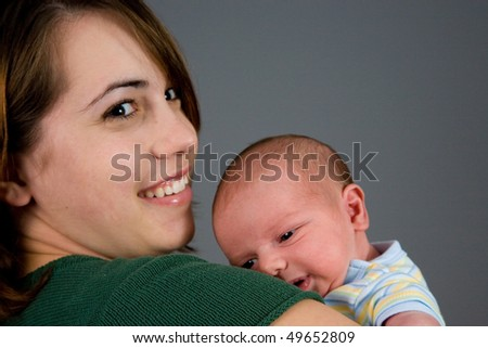 A portrait of a newborn baby boy and his mother. Ten days old. - stock photo