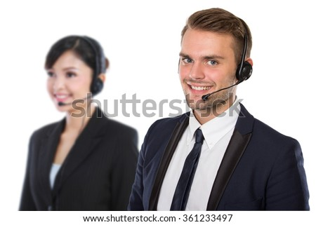 A portrait of a pair of Employee of call center with a headset on - stock photo