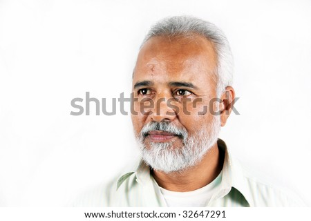 A portrait of a senior Indian man on a white background. - stock photo