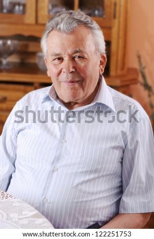 A portrait of a senior man indoors - stock photo