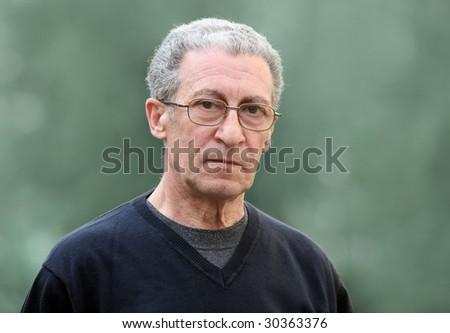 A portrait of a serious senior man - stock photo