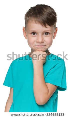 A portrait of a smiling little boy in a blue shirt on the white background - stock photo