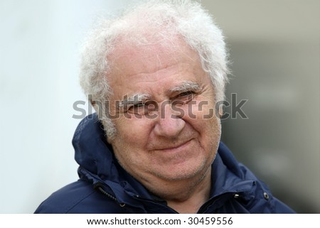 A portrait of a smiling old man - stock photo
