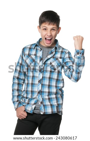 A portrait of a successful preteen boy on the white background - stock photo
