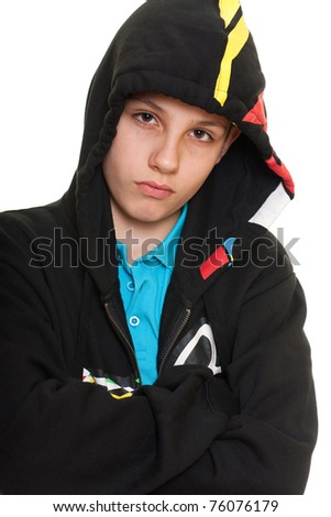A portrait of a thoughtful boy in black sweatshirt; isolated on the white background - stock photo