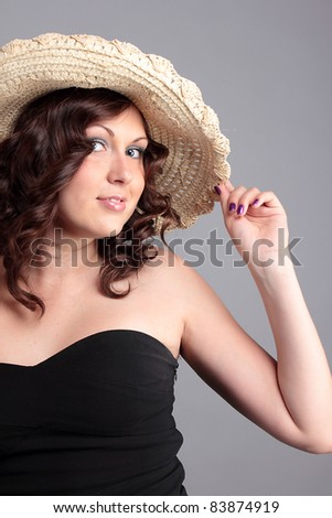 A portrait of a woman with a hat - stock photo